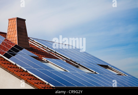 Photovoltaic solar panels mounted on the roof of a German house. - Stock Photo