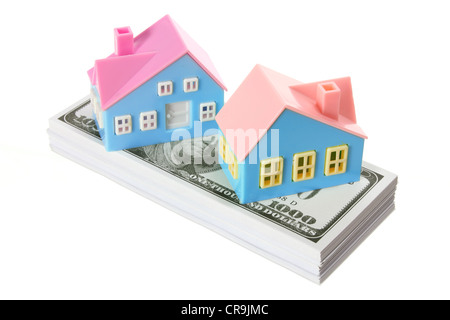 Toy Houses with Dollar Notes - Stock Photo