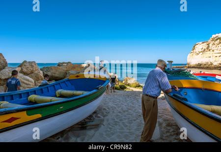 Portugal, Algarve, fishermen on the beach of Carvoeiro - Stock Photo
