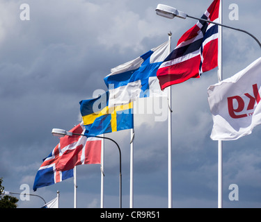 Flags of the nordic countries (from left to right Iceland, Denmark, Sweden, Finland and Norway) fly in the harbour - Stock Photo