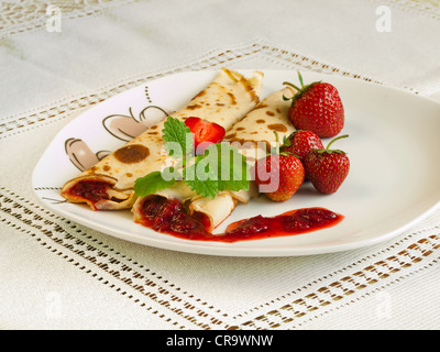 Rolled pancakes with strawberries - Stock Photo
