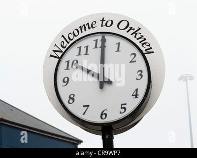 Welcome to Orkney clock in the misty port at Stromness, Orkney Islands, Scotland, UK - Stock Photo