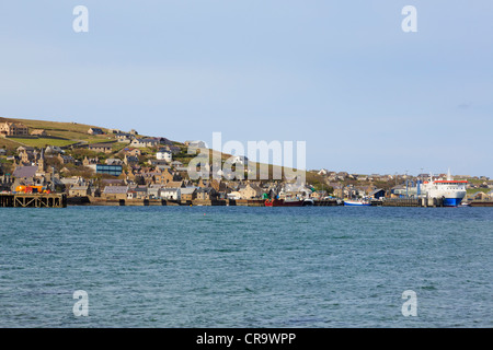 Stromness Orkney Islands Scotland UK. View of town and port from across harbour with Northlink ferry to Scrabster - Stock Photo