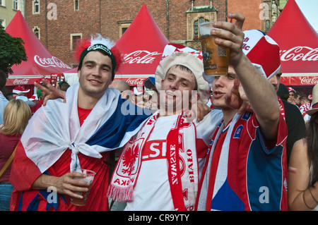 Czech and Polish soccer fans during EURO 2012 Football Championship at Fan Zone at Rynek (Market Square) in Wrocław, - Stock Photo