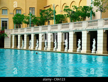 Line of Statues overlooking beautiful swimming pool at the historic Biltmore Hotel Coral Gables Miami Florida - Stock Photo