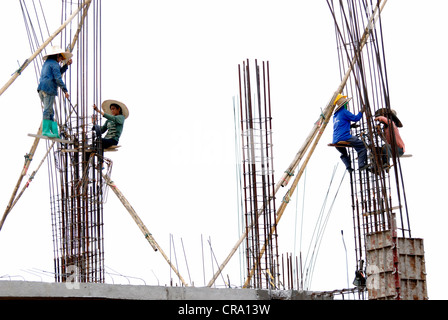 Female construction workers  workers 0n 2/06/2012 in Lamphun Thailand - Stock Photo