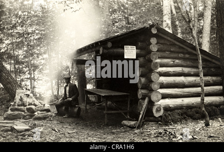 Camper at Log Cabin Camp Lean-to - Stock Photo