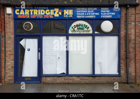 A provider of copying and printing services, closed down, just another of the many high street casualties of the - Stock Photo