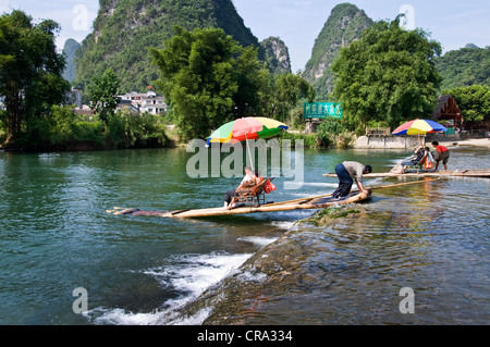 Wood rafts on Li river in  Yangshuo, Guangxi province - China - Stock Photo