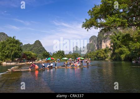 Wood rafts on Li river in  Yangshuo, Guangxi province - China - Stock Photo