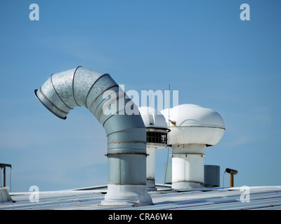 Plant roof with various outlets and exhaust pipes - Stock Photo