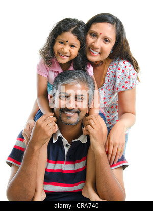 Happy Asian Indian family stacking on white background - Stock Photo