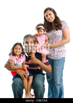 Happy modern Indian family portrait on white background - Stock Photo