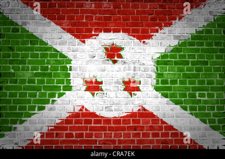 An image of the Burundi flag painted on a brick wall in an urban location - Stock Photo