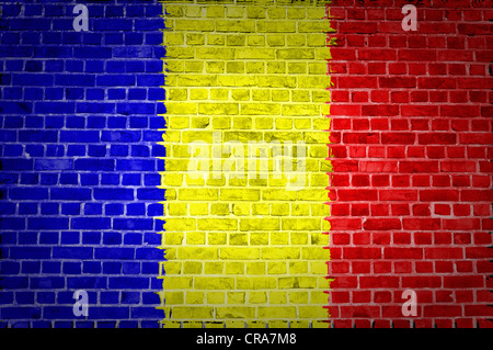 An image of the Chad flag painted on a brick wall in an urban location - Stock Photo