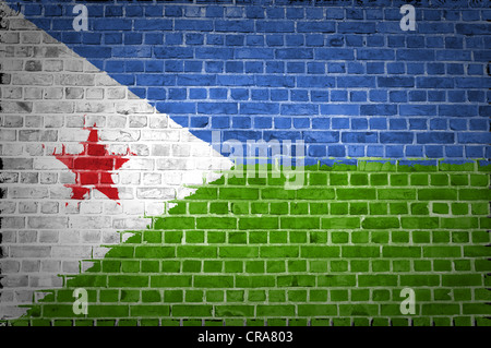 An image of the Djibouti flag painted on a brick wall in an urban location - Stock Photo