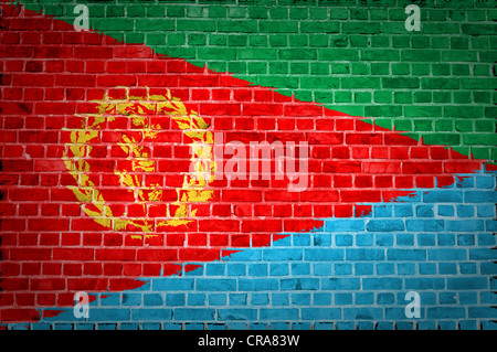 An image of the Eritrea flag painted on a brick wall in an urban location - Stock Photo