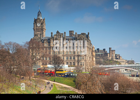The Balmoral Hotel, Edinburgh, in Spring with the tourist city tour buses parked opposite Waverley railway station. - Stock Photo