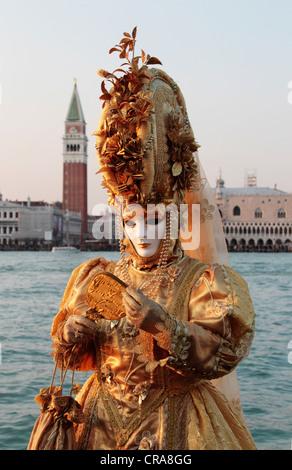 Woman wearing a mask, Carnival in Venice, San Giorgio Maggiore, Venice, Veneto, Italy, Europe - Stock Photo