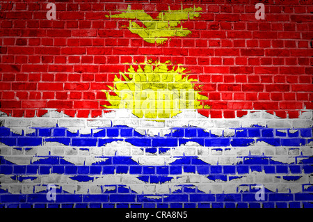 An image of the Kiribati flag painted on a brick wall in an urban location - Stock Photo