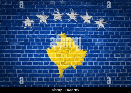 An image of the Kosovo flag painted on a brick wall in an urban location - Stock Photo
