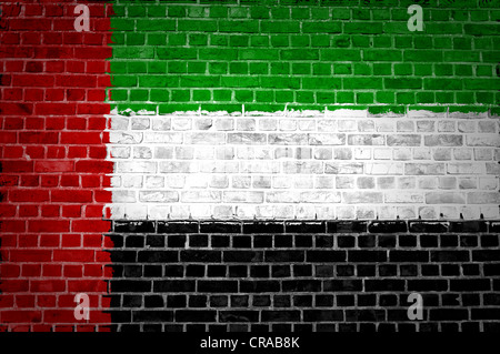 An image of the United Arab Emirates flag painted on a brick wall in an urban location - Stock Photo