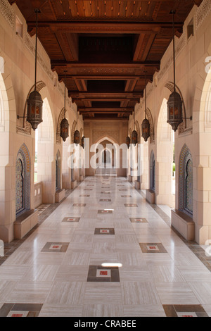 Colonade, wooden ceiling, arch, Sultan Qaboos Grand Mosque, Muscat capital, Sultanate of Oman, gulf states, Arabic - Stock Photo