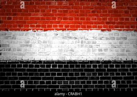 An image of the Yemen flag painted on a brick wall in an urban location - Stock Photo
