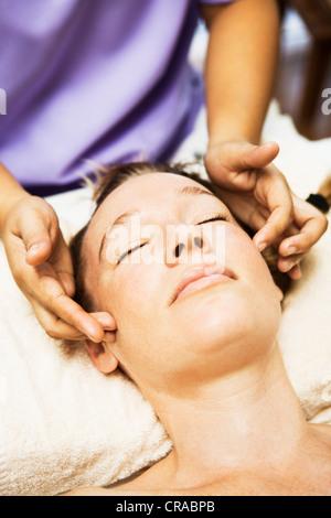 Woman having scalp massage in spa - Stock Photo