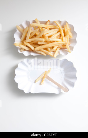 French fries on paper plates, diet - Stock Photo