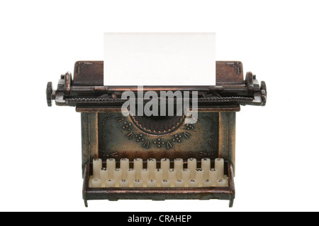 Old typewriter with a blank sheet - Stock Photo