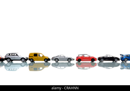 Miniature cars in a row - Stock Photo
