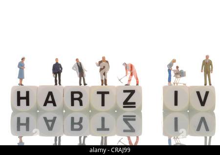 Various figures standing on the words Hartz IV - Stock Photo