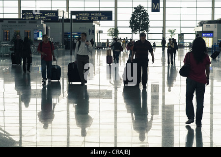 Interior of Terminal 2 at Pudong International Airport in Shanghai China - Stock Photo
