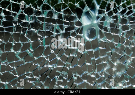 Shattered glass of a phone booth - Stock Photo