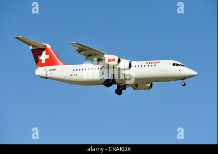 Swiss BAE Systems Avro 146-RJ100 during the landing approach to Zurich Airport, Zurich, Switzerland, Europe - Stock Photo