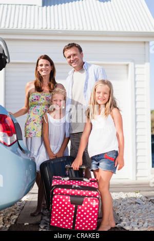 Family loading up car trunk - Stock Photo