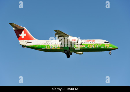 Swiss BAE Systems Avro 146-RJ100 with special livery, Shopping Paradise Zurich Airport, during the landing approach - Stock Photo