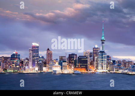 Auckland, New Zealand's largest city, under a dramatic twilight sky. - Stock Photo