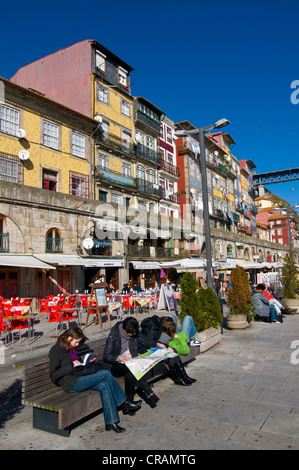 Tourists along the promenade on the banks of the Rio Douro river, Porto, Portugal, Europe - Stock Photo