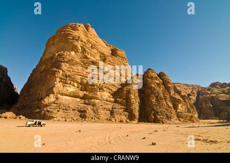Rocks, an off-road vehicle in front, desert, Wadi Rum, Jordan, Middle East - Stock Photo