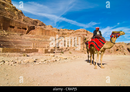 Man riding a camel, Petra, Jordan, Middle East - Stock Photo