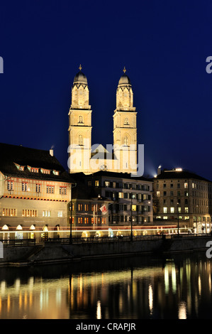 Limmat river, Limmatquai quay with Zunfthaus zum Rueden guildhall and Grossmuenster great minster in the old town - Stock Photo