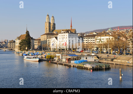 View from the Quai bridge over the Limmat river to the Limmatquai quay with the Grossmuenster great minster, Zurich - Stock Photo