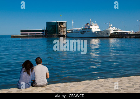 Couple on the promenade of Baku, Azerbaijan, Middle East - Stock Photo