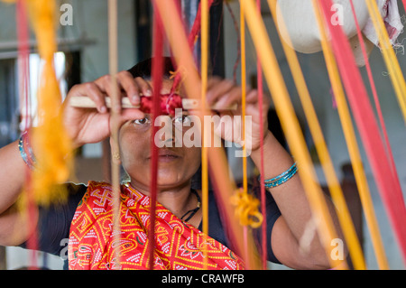 Weaver weaving, Ahilya Fort, Maheshwar, Madhya Pradesh, India, Asia - Stock Photo