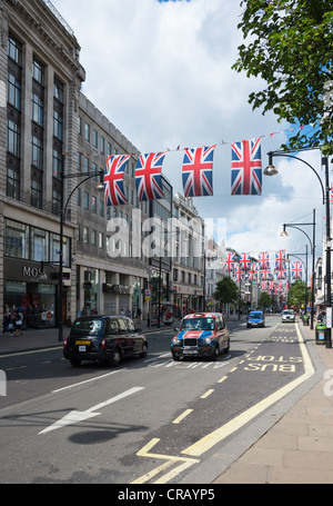 London Taxi cabs on Oxford Street, London, England. - Stock Photo