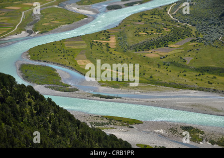Reting river, Reting Tsangpo, with centuries-old juniper trees in the mountains of Reting Monastery, Mount Gangi - Stock Photo