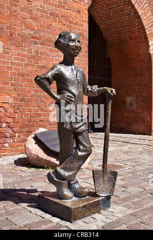 Elblag, Piekarczyk figure near old gate, Poland - Stock Photo
