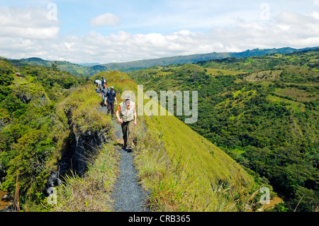Hikers on Paso del Angel, a narrow pass in Santa Sofia, Villa de Leyva, Boyaca department, Colombia, South America - Stock Photo